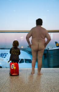 naked man standing in the Nashville International Airport
