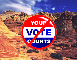 "A badge reading ""your vote counts"" with a red cross over it floats above an Arizona landscape"