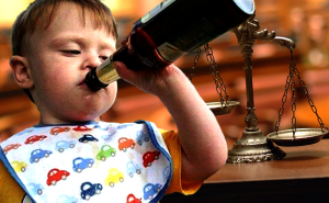 baby drinks wine in a courtroom