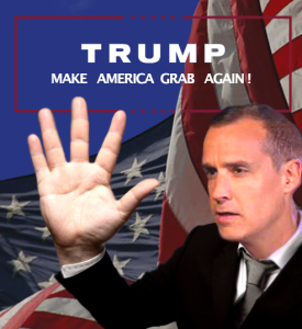 Corey Lewandowski looks at his giant hand in front of an American flag and the Trump campaign slogan