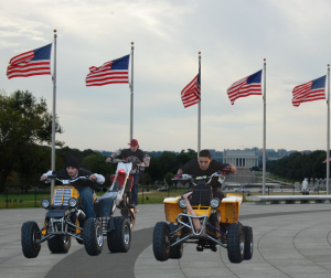 ATV riders drive around the Washington Monument