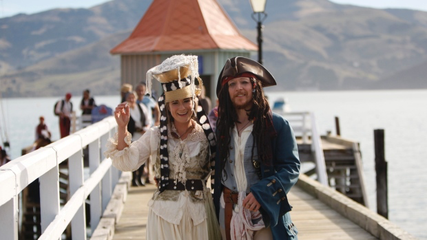 Pastafarian newlyweds pose in pirate costumes