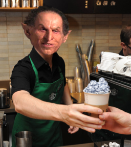 a goblin working at starbucks hands a customer a cup full of ice