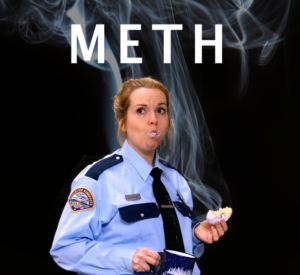 """a police officer eats a donut, holds a coffee, and stands in front of smoke under the word """"METH"""""""