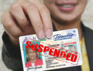 man holds suspended license