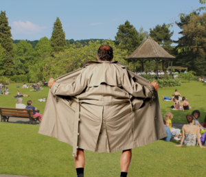 man in trenchcoat flashes busy park