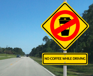 "a roadsign reads ""no coffee while driving"""