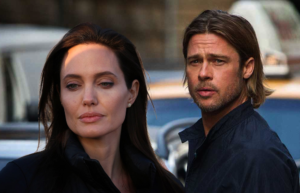 Angelina Jolie walks away from sad Brad in the street