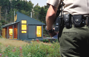 a cop approaches an off-the-grid cabin