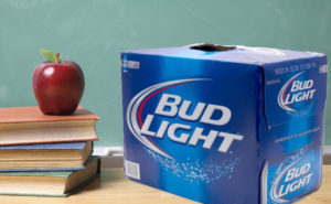 a case of bud light sits on a teacher's desk