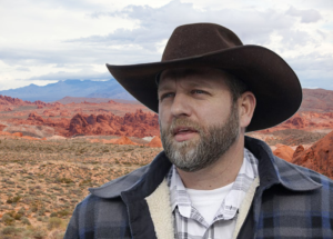 Ammon Bundy stands before a classic nevada landscape